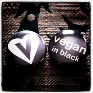 vegan in black buttons